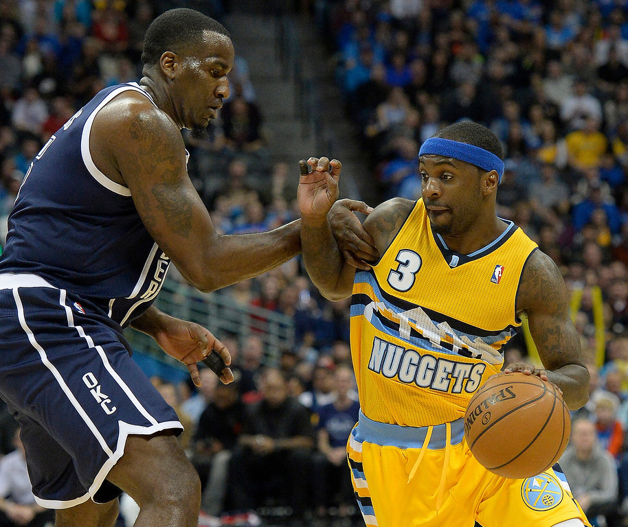 . Denver Nuggets point guard Ty Lawson (3) gets a little push by ,o5 as he drives to the basket during the first quarter January 9, 2014 at Pepsi Center. (Photo by John Leyba/The Denver Post)