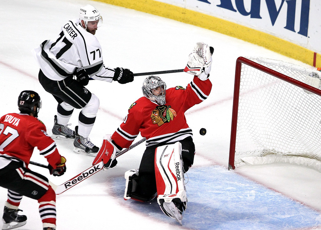 . Jeff Carter #77 of the Los Angeles Kings scores a goal against Corey Crawford #50 of the Chicago Blackhawks in the first period during Game Seven of the Western Conference Final in the 2014 Stanley Cup Playoffs at United Center on June 1, 2014 in Chicago, Illinois.  (Photo by Tasos Katopodis/Getty Images)