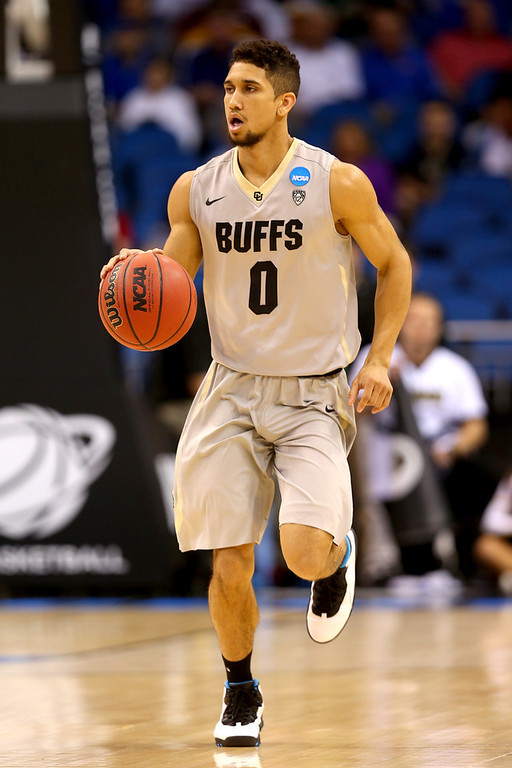 . Askia Booker #0 of the Colorado Buffaloes moves the ball against the Pittsburgh Panthers during the second round of the 2014 NCAA Men\'s Basketball Tournament at Amway Center on March 20, 2014 in Orlando, Florida.  (Photo by Mike Ehrmann/Getty Images)