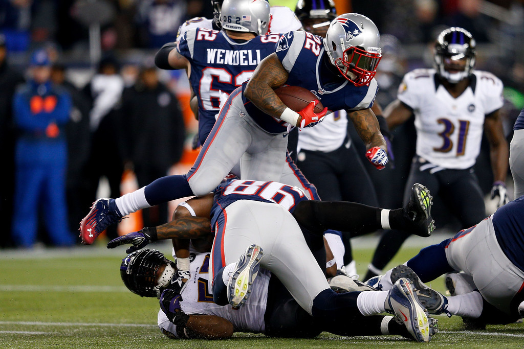 . Stevan Ridley #22 of the New England Patriots runs the ball against the Baltimore Ravens during the 2013 AFC Championship game at Gillette Stadium on January 20, 2013 in Foxboro, Massachusetts.  (Photo by Jim Rogash/Getty Images)