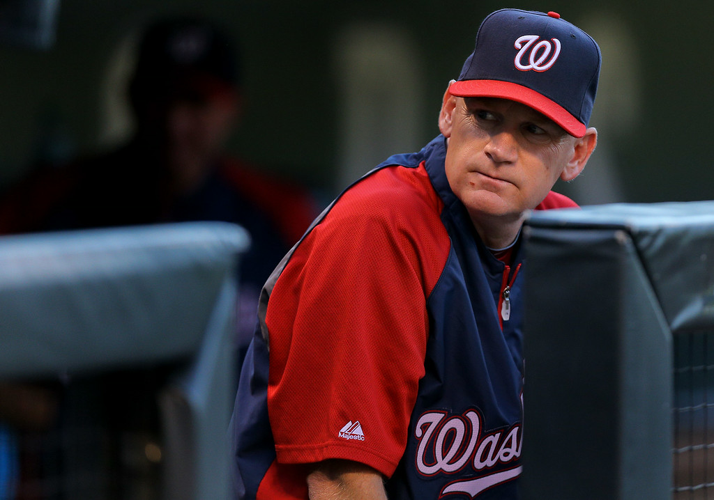 . DENVER, CO - JULY 22:  Manager Matt Williams of the Washington Nationals looks on from the dugout during the first inning against the Colorado Rockies at Coors Field on July 22, 2014 in Denver, Colorado.  (Photo by Justin Edmonds/Getty Images)