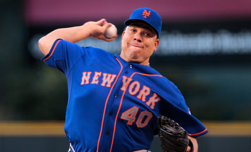 . New York Mets starting pitcher Bartolo Colon (40) delivers in the first inning of a baseball game against the Colorado Rockies in Denver, Thursday, May 1, 2014. (AP Photo/Joe Mahoney)
