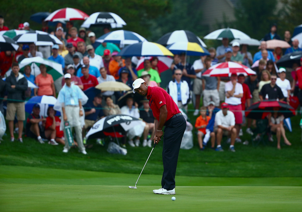 . DUBLIN, OH - OCTOBER 05:  Tiger Woods of the U.S. Team putts for eagle on the fifth green during the Day Three Four-ball Matches at the Muirfield Village Golf Club on October 5, 2013  in Dublin, Ohio.  (Photo by Andy Lyons/Getty Images)