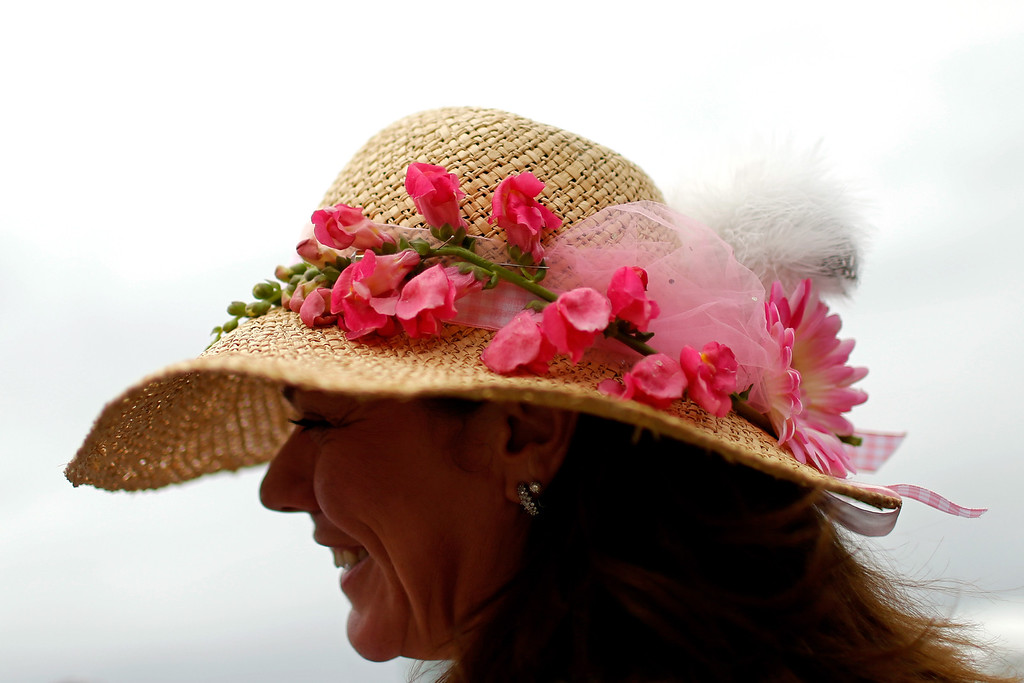 . BALTIMORE, MD - MAY 18:  A fan attends the 138th running of the Preakness Stakes at Pimlico Race Course on May 18, 2013 in Baltimore, Maryland.  (Photo by Molly Riley/Getty Images)