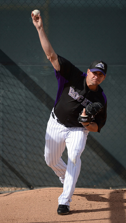 . SCOTTSDALE, AZ. - FEBRUARY 19: Colorado Rockies Rafael Betancourt (63) warms up his arm before pitching batting practice during Spring Training February 19, 2013 in Scottsdale. (Photo By John Leyba/The Denver Post)