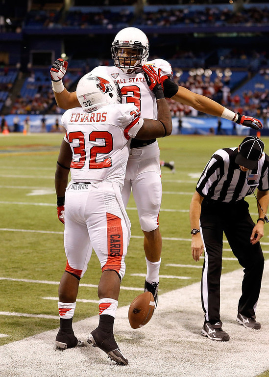 . Receiver Willie Snead #3 of the Ball State Cardinals celebrates his touchdown with Jahwan Edwards #32 against the Central Florida Knights during the Beef \'O\' Brady\'s St Petersburg Bowl Game at Tropicana Field on December 21, 2012 in St Petersburg, Florida.  (Photo by J. Meric/Getty Images)