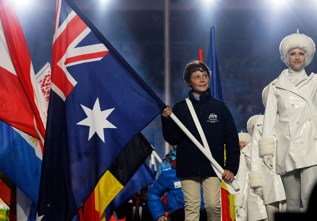 . Snowboarder Ben Tudhope of Australia carries the flag of Australia during the closing ceremony of the 2014 Winter Paralympics at the Fisht Olympic stadium in Sochi, Russia, Sunday, March 16, 2014. (AP Photo/Dmitry Lovetsky)