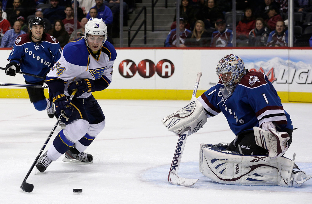 . St. Louis Blues right wing T.J. Oshie (74) shoots on Colorado Avalanche goalie Semyon Varlamov, of Russia, during the second period of an NHL hockey game, Wednesday, Feb. 20, 2013, in Denver. (AP Photo/Joe Mahoney)
