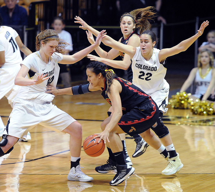 . Kiki Alofaituli of USC is trapped by Rachel Hargis, left, and Haley Smith of Colorado  during the first half of the March 2, 2014 game in Boulder, Colo.  (Class Grassmick/Daily Camera)