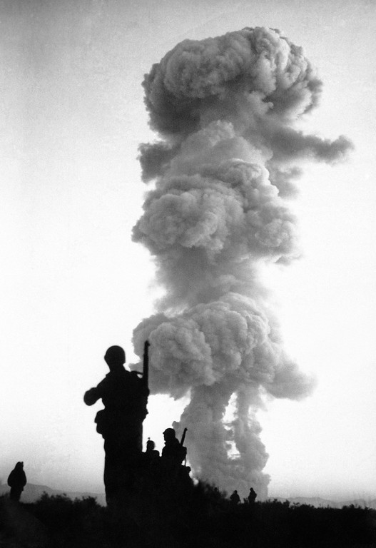 ". Troops of the U.S. Sixth Army, stationed at Camp Desert Rock, advance on the ""enemy\"" moments after an atomic blast at Yucca Flats, near Las Vegas, Nev., June 1, 1952 This blast concluded troop maneuvers in conjunction with atomic operations at the Nevada proving grounds. (AP Photo/HO)"