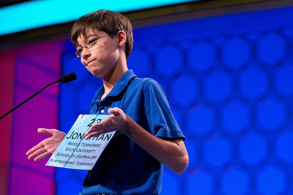 """. Jonathan Caldwell, 13, of Hendersonville, Tenn., shrugs his shoulders after getting the word \""""pergameneous\"""" incorrect during the semifinal round of the National Spelling Bee on Thursday, May 30, 2013, in Oxon Hill, Md. (AP Photo/Evan Vucci)"""