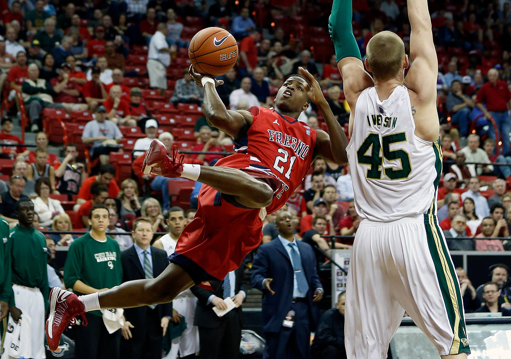 . Fresno State\'s Allen Huddleston, shoots against Colorado State\'s Colton Iverson during the first half of a Mountain West Conference tournament NCAA college basketball game on Wednesday, March 13, 2013, in Las Vegas. (AP Photo/Isaac Brekken)