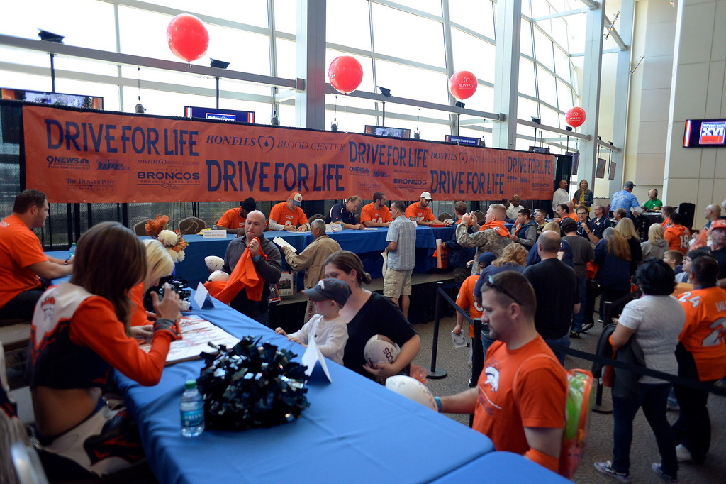 . DENVER, CO - OCTOBER 22: Hundreds gathered for The Denver Broncos and Bonfils Blood Center\'s 16th annual Drive for Life community blood drive October 22, 2013 at Sports Authority Field. (Photo by John Leyba/The Denver Post)
