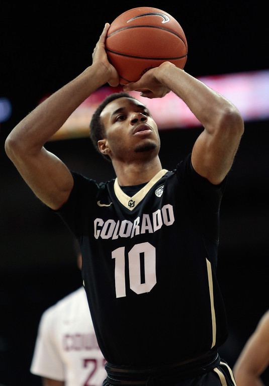 . Tre\'Shaun Fletcher #10 of the Colorado Buffaloes takes a foul shot during the game against the Washington State Cougars at Spokane Arena on January 8, 2014 in Spokane, Washington.  (Photo by William Mancebo/Getty Images)