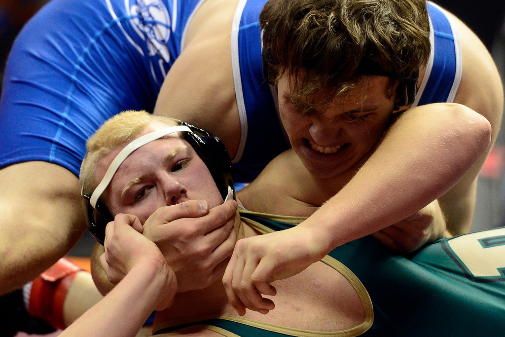 . DENVER, CO - FEBRUARY 21: Pueblo Central 220-pounder Evan Lancelot works Pueblo County\'s Kenny Hardwick en route to a win by way of fall during the Colorado State High School Wrestling Championships. The state finals will run through Saturday evening at the Pepsi Center. (Photo by AAron Ontiveroz/The Denver Post)