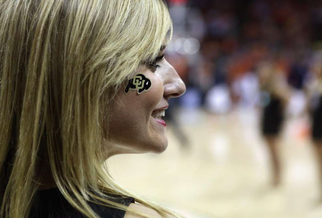 . AUSTIN, TX - MARCH 22:  A cheerleader of the Colorado Buffaloes watches the game against the Illinois Fighting Illini during the second round of the 2013 NCAA Men\'s Basketball Tournament at The Frank Erwin Center on March 22, 2013 in Austin, Texas.  (Photo by Stephen Dunn/Getty Images)