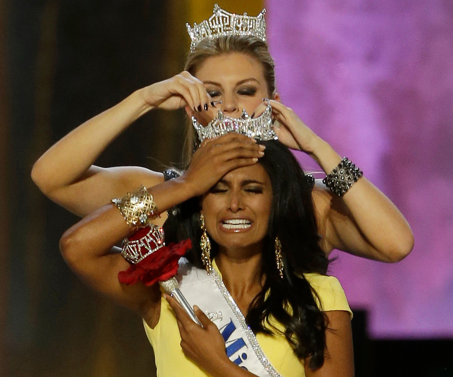 . Miss New York Nina Davuluri, front, is crowned as Miss America 2014 by Miss America 2013 Mallory Hagan, Sunday, Sept. 15, 2013, in Atlantic City, N.J. (AP Photo/Mel Evans)