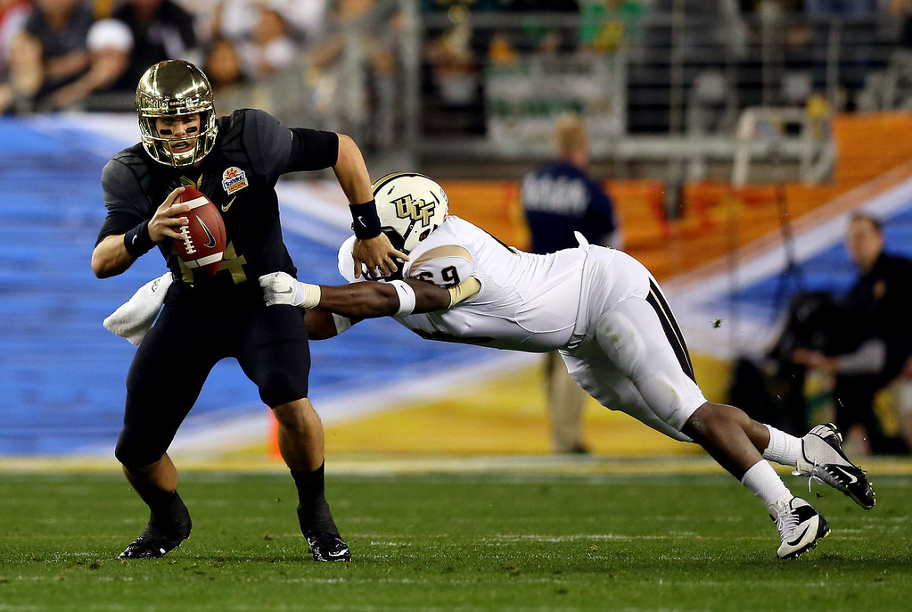 . GLENDALE, AZ - JANUARY 01: Defensive lineman Thomas Niles #69 of the UCF Knights sacks quarterback Bryce Petty #14 of the Baylor Bears in the first quarter during the Tostitos Fiesta Bowl at University of Phoenix Stadium on January 1, 2014 in Glendale, Arizona.  (Photo by Ronald Martinez/Getty Images)