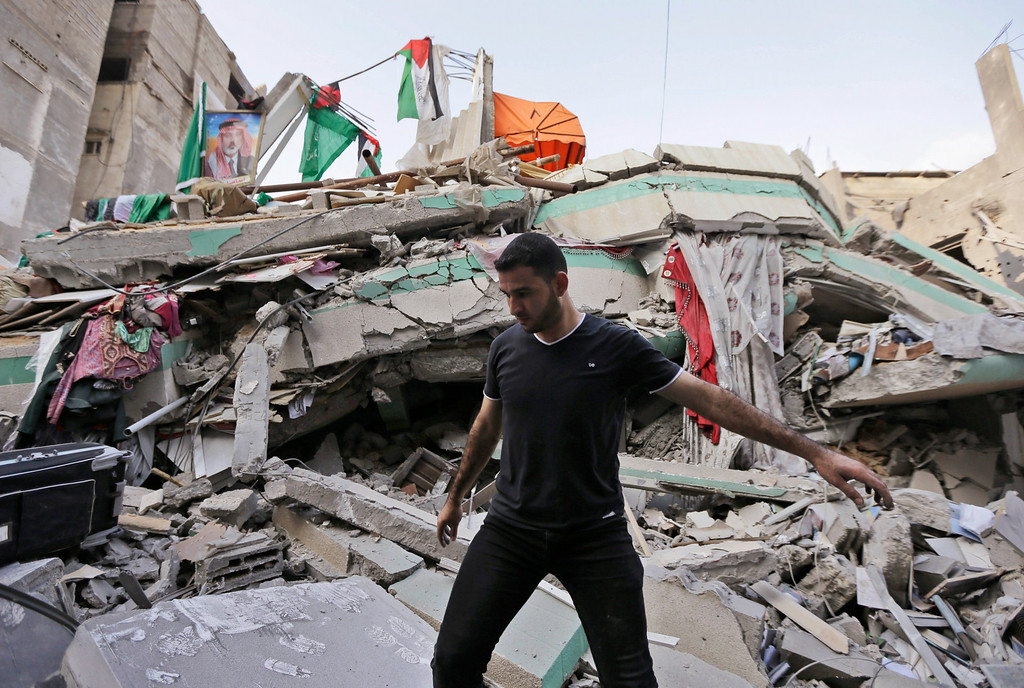 . A Palestinian walks on the rubble of the house of the top Hamas leader in Gaza, Ismail Haniyeh, hit by a pre-dawn Israeli strike, in Gaza City, northern Gaza Strip, Tuesday, July 29, 2014. (AP Photo/Lefteris Pitarakis)