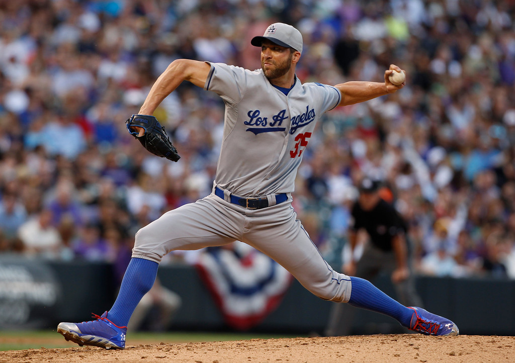 . Los Angeles Dodgers starting pitcher Chris Capuano works against the Colorado Rockies in the third inning of a baseball game in Denver, Thursday, July 4, 2013. (AP Photo/David Zalubowski)