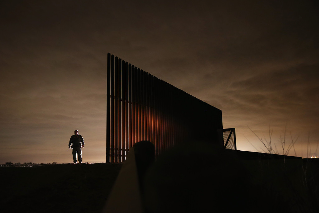 . LA JOYA, TX - APRIL 10:  U.S. Border Patrol agent Sal De Leon stands near a section of the U.S.- Mexico border fence while stopping on patrol on April 10, 2013 in La Joya, Texas. According to the Border Patrol, undocumented immigrant crossings have increased more than 50 percent in Texas\' Rio Grande Valley sector in the last year. Border Patrol agents say they have also seen an additional surge in immigrant traffic since immigration reform negotiations began this year in Washington D.C. Proposed refoms could provide a path to citizenship for many of the estimated 11 million undocumented workers living in the United States.  (Photo by John Moore/Getty Images)