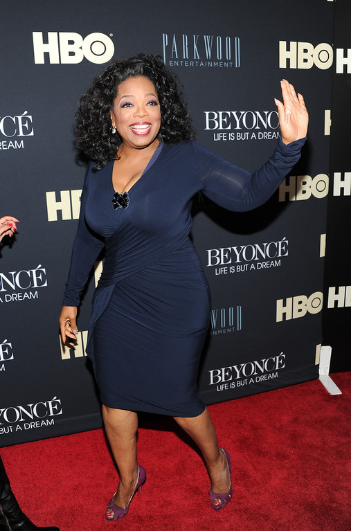 ". Oprah Winfrey attends the premiere of ""Beyonce: Life Is But A Dream\"" at the Ziegfeld Theatre on Tuesday, Feb. 12, 2013 in New York. (Photo by Evan Agostini/Invision/AP)"