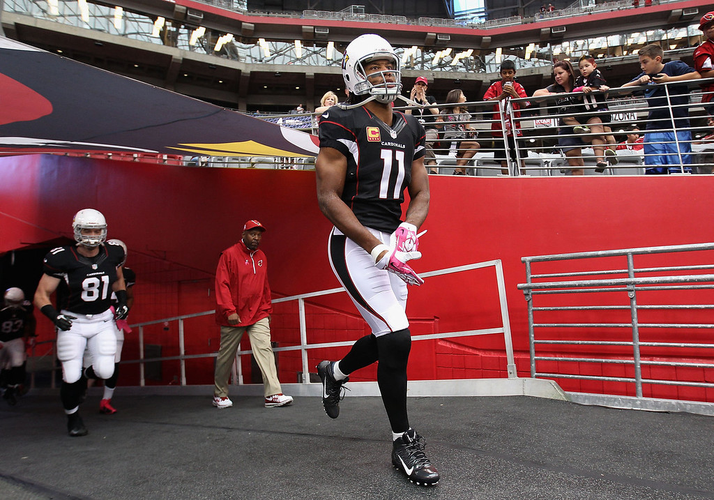 . Wide receiver #11 of the Arizona Cardinals walks out onto the field before the NFL game against the Carolina Panthers at the University of Phoenix Stadium on October 6, 2013 in Glendale, Arizona.  (Photo by Christian Petersen/Getty Images)