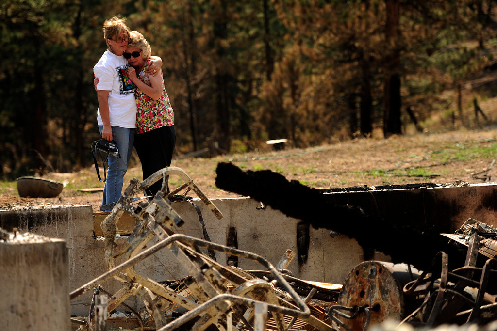 . Deanna Skelton is comforted by her daughter, Lucinda Able, during the their first visit to the home, which was burned by the High Park Fire on Stove Prairie Road on Sunday, July 1, 2012. AAron Ontiveroz, The Denver Post. AAron Ontiveroz, The Denver Post