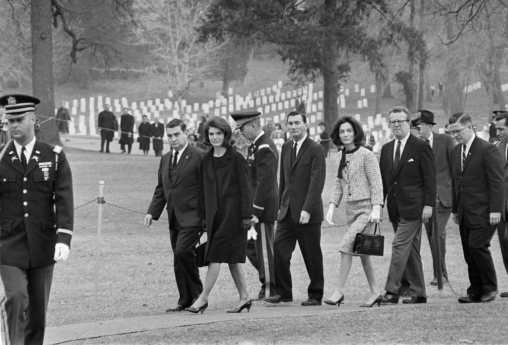 . Jacqueline Kennedy walks toward her late husband\'s grave in Arlington National Cemetery Thanksgiving Day, Nov. 28, 1963. Beside her is White House press secretary Pierre Salinger. Behind her is her sister Lee Radziwill and, behind her, Lawrence O\'Brien, special assistant to President Kennedy. Others are unidentified. Bob Schutz, Associated Press file