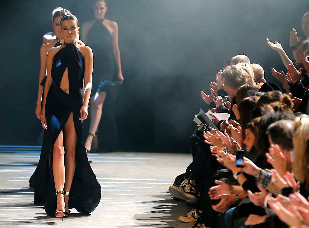 . Models wear creations by French fashion designer Alexandre Vauthier as part of the Women\'s Spring/Summer 2013 Haute Couture fashion collection presented in Paris, Tuesday, Jan. 22 2013 (AP Photo/ Jacques Brinon)