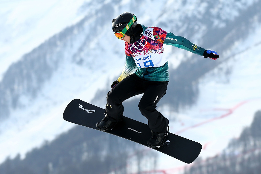 . Belle Brockhoff of Australia competes during the Ladies\' Snowboard Cross Seeding on day nine of the Sochi 2014 Winter Olympics at Rosa Khutor Extreme Park on February 16, 2014 in Sochi, Russia.  (Photo by Cameron Spencer/Getty Images)