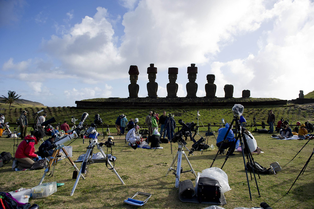 . Tourists and  scientists prepare their equipment  before a solar total eclipse on Easter Island, 3,700 km off the Chilean coast in the Pacific Ocean, on July 11, 2010. Hundreds of scientists, tourists and locals were expecting to see from the Easter Island the almost five-minute total eclipse , at the same time of the FIFA World Cup South Africa 2010 final. MARTIN BERNETTI/AFP/Getty Images