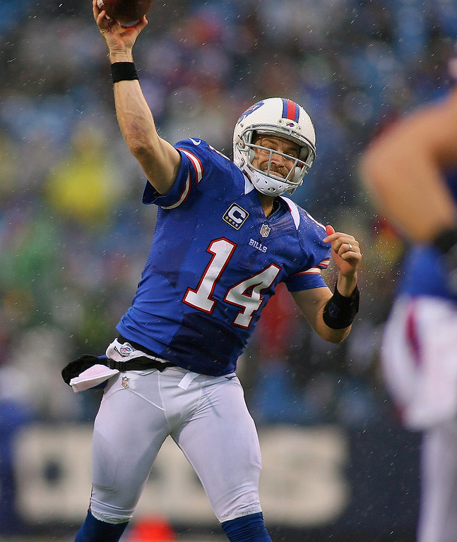 . Ryan Fitzpatrick #14 of the Buffalo Bills throws a touchdown pass to  Scott Chandler #84 of the Buffalo Bills against the Jacksonville Jaguars at Ralph Wilson Stadium on December 2, 2012 in Orchard Park, New York.  (Photo by Rick Stewart/Getty Images)