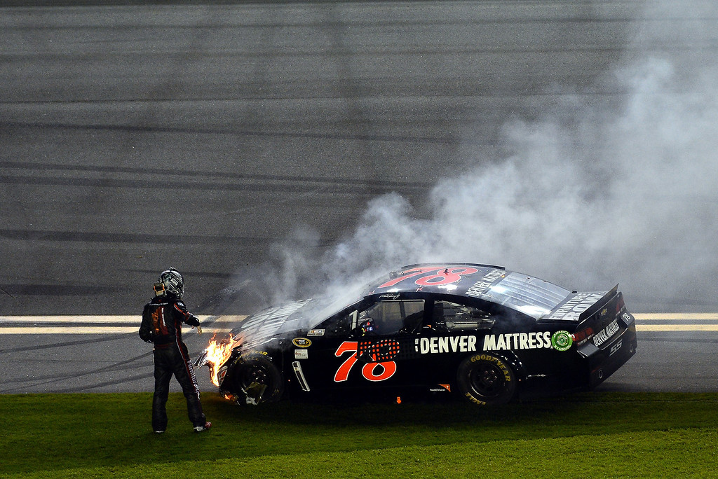 . Martin Truex Jr., driver of the #78 Furniture Row Chevrolet, stands next to his car after an incident on the last lap of the NASCAR Sprint Cup Series Budweiser Duel 2 at Daytona International Speedway on February 20, 2014 in Daytona Beach, Florida.  (Photo by Jared C. Tilton/Getty Images)
