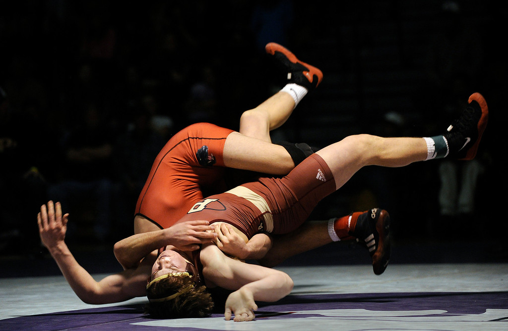 . ARVADA, CO - JANUARY 19: Ponderosa High School wrestler Kelton Good, bottom, battled Pomona\'s Ethan Wright, top, during the deciding bout in the 152-pound weight class Saturday night. Good prevailed 4-3. The Arvada West High School wrestling tournament wrapped up Saturday night, January 19, 2013. Karl Gehring/The Denver Post