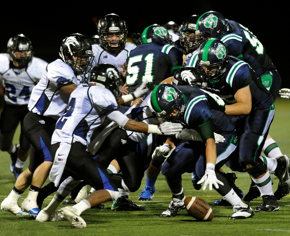 . HIGHLANDS RANCH, CO. - SEPTEMBER 13: ThunderRidge halfback Tristan Powers (81) recovered his own fumble late in the fourth quarter. The ThunderRidge High School football team defeated Grandview 21-7 at Shea Stadium Friday night, September 13, 2013.  Photo By Karl Gehring/The Denver Post