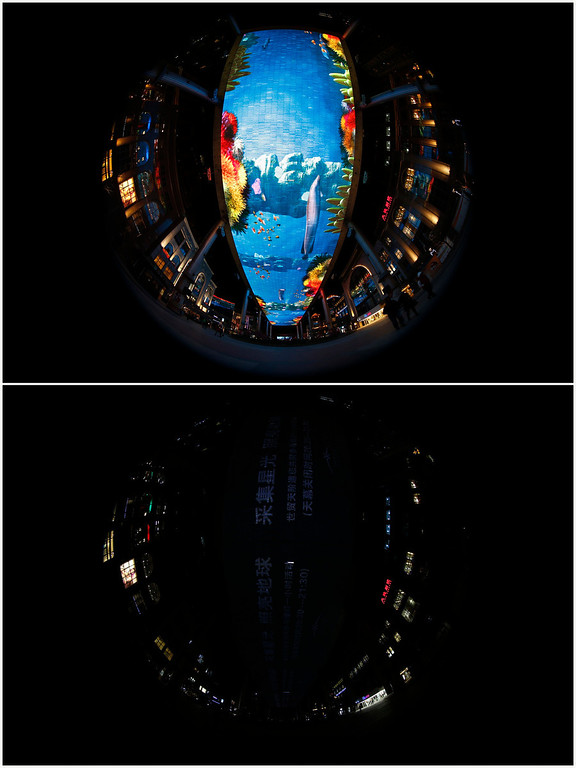 . A combination picture shows the world largest LCD screen at a shopping mall before Earth Hour (top) and during Earth Hour in Beijing March 23, 2013. Earth Hour, when everyone around the world is asked to turn off lights for an hour from 8.30 p.m. local time, is meant as a show of support for tougher action to confront climate change. Picture taken with fisheye lens.   REUTERS/Kim Kyung-Hoon