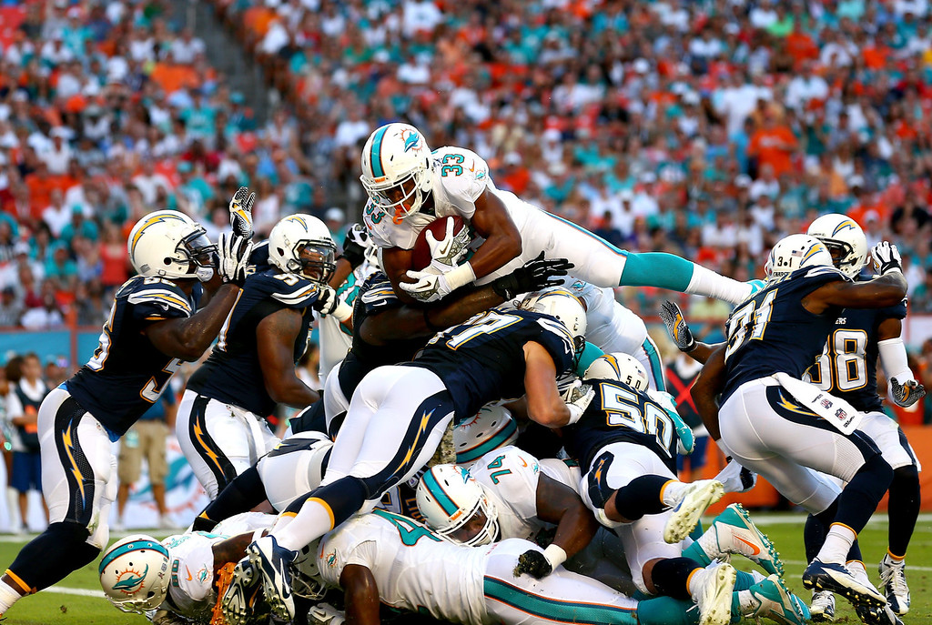 . Daniel Thomas #33 of the Miami Dolphins dives for a touchdown during their game against the San Diego Chargers at Sun Life Stadium on November 17, 2013 in Miami Gardens, Florida.  (Photo by Streeter Lecka/Getty Images)
