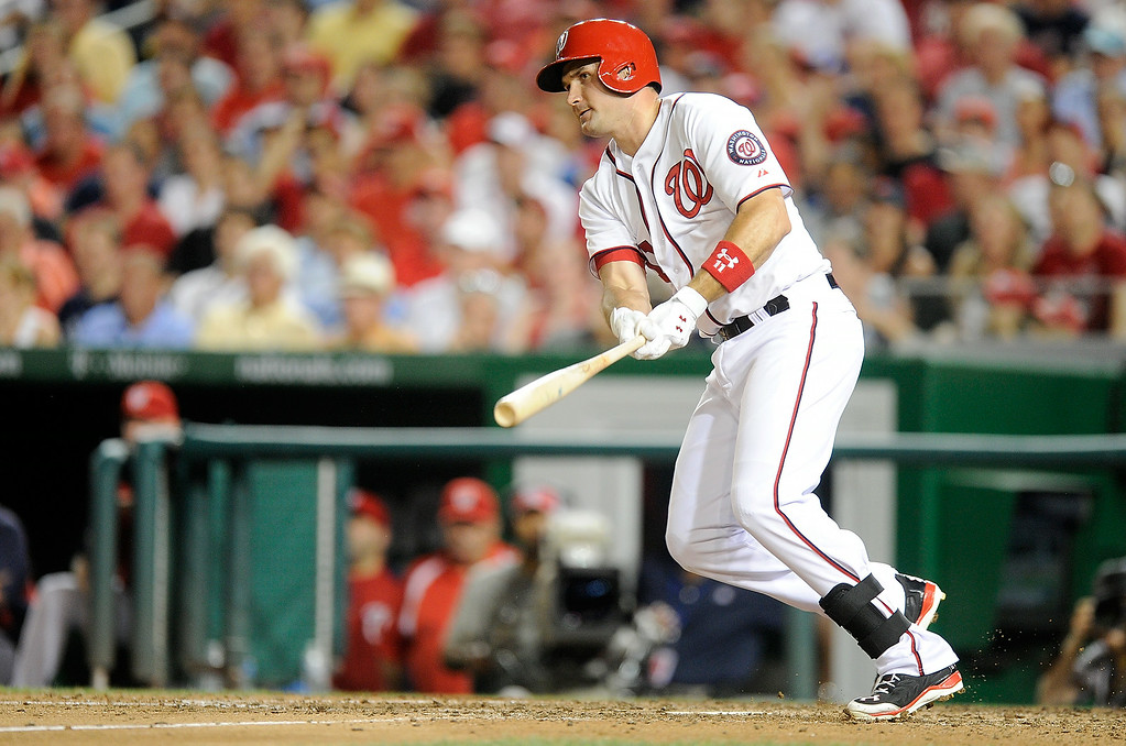 . WASHINGTON, DC - JUNE 30: Ryan Zimmerman #11 of the Washington Nationals hits a double in the sixth inning against the Colorado Rockies at Nationals Park on June 30, 2014 in Washington, DC.  (Photo by Greg Fiume/Getty Images)
