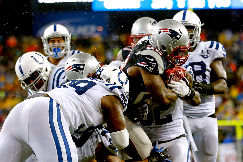 . FOXBORO, MA - JANUARY 11:  Stevan Ridley #22 of the New England Patriots scores in the third quarter against the Indianapolis Colts during the AFC Divisional Playoff game at Gillette Stadium on January 11, 2014 in Foxboro, Massachusetts.  (Photo by Jim Rogash/Getty Images)