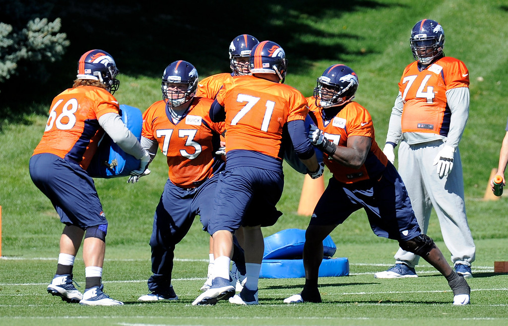 . Denver Broncos offensive line gets in reps during practice September 25, 2013 at Dove Valley. (Photo by John Leyba/The Denver Post)