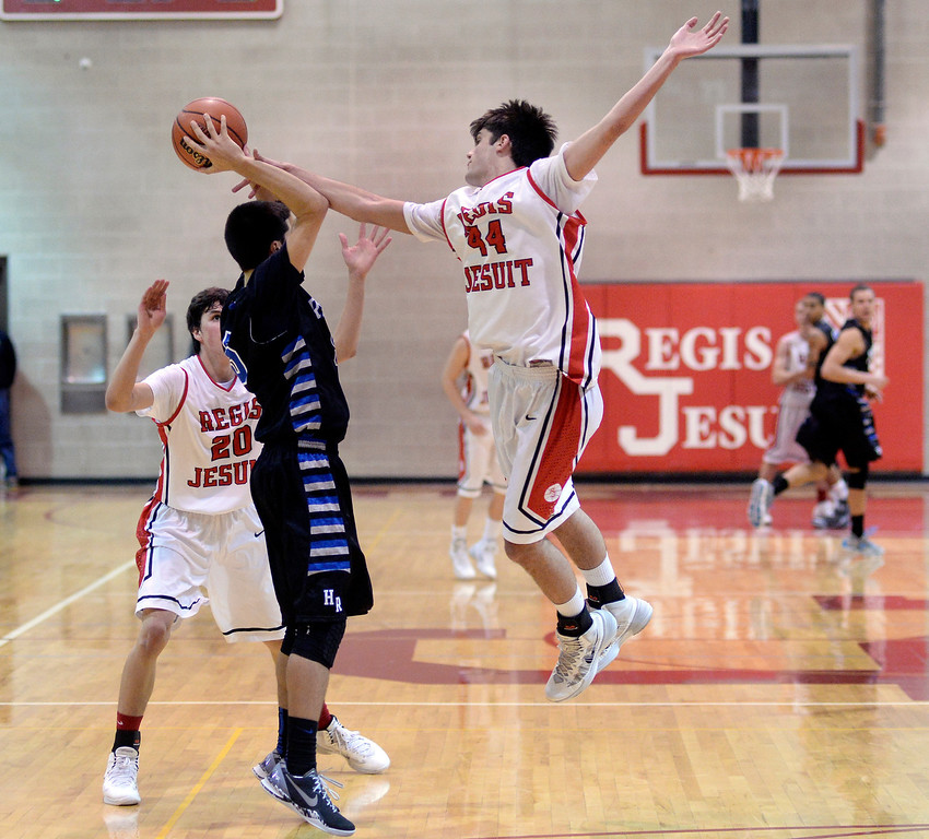 . Regis forwards Kip Boryla (44) and Devin Kadillak (20) pressured Ranch senior Cole Sundlof (5) in the second half. The Regis Jesuit High School boy\'s basketball team defeated Highlands Ranch 63-54 Tuesday night, February 4, 2014. Photo By Karl Gehring/The Denver Post