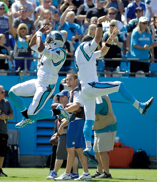 . Carolina Panthers quarterback Cam Newton, left, and Derek Anderson, right, celebrate a  touchdown against the New York Giants during the first half of an NFL football game in Charlotte, N.C., Sunday, Sept. 22, 2013. (AP Photo/Bob Leverone)