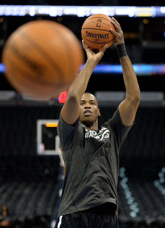 . DENVER, CO. - FEBRUARY 27, 2014: Brooklyn center Jason Collins warmed up on the court before the Nuggets game Thursday night, February 27, 2014. Collins made headlines recently when he came out as gay. Photo By Karl Gehring/The Denver Post