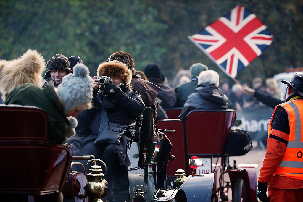 . Participants wait for the start of the Royal Automobile Club\'s annual Veteran Car Run in Hyde Park on November 3, 2013 in London, England. Around 500 eligible pre-1905 cars take part in The Royal Automobile Club\'s annual 60-mile drive from Hyde Park in central London to the seafront on the Sussex resort of Brighton. It is the longest running motoring event in the world, and attracts entrants from across the globe.  (Photo by Matthew Lloyd/Getty Images)