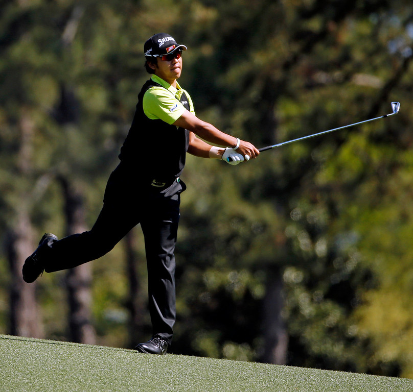. Hideki Matsuyama, of Japan, hits off the second fairway during the first round of the Masters golf tournament Thursday, April 10, 2014, in Augusta, Ga. (AP Photo/Matt Slocum)