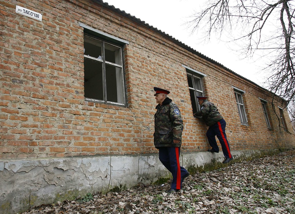 . Cossacks check an empty building as they patrol an area near Russian-Ukraininian border near the southern city of Rostov-on-Don, on March 19, 2014. But by snatching Crimea from Ukraine, President Vladimir Putin has shown a readiness to redraw Russia\'s current frontiers and shatter the order that dates from the so-called Belovezhskaya Accords.AFP PHOTO / ANDREY  KRONBERG/AFP/Getty Images