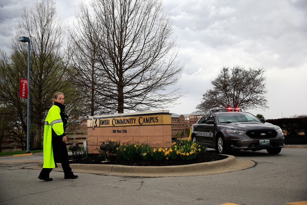 . A police woman and police car are seen at the entrance of the Jewish Community Center after three were killed when a gunman opened fire on April 13, 2014 in Overland Park, Kansas. Police arrested and are questioning a suspect.  (Photo by Jamie Squire/Getty Images)