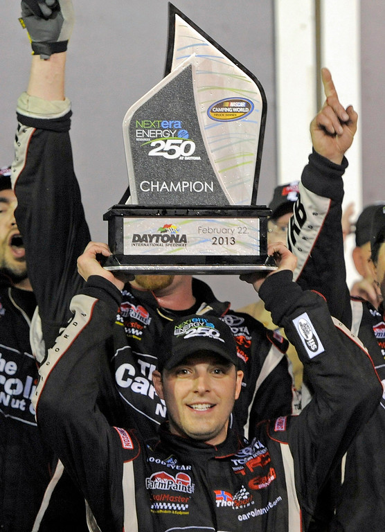 . Johnny Sauter (C) celebrates in the victory lane after winning the NASCAR Camping World Truck Series NextEra Energy Resources 250 race at the Daytona International Speedway in Daytona Beach, Florida February 22, 2013. The Daytona 500 NASCAR Sprint Cup race is scheduled for February 24.  REUTERS/Brian Blanco