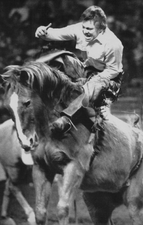 . Rough Ride - Joe Rude of Baker, Oregon is thrown to the neck of Velvet Patchwork in the Bareback Bronc Riding competition on Friday at the National Western Stock Show and Rodeo in Denver. 1983. AP Laserphoto